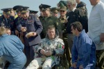 Roberto Vittori (Italy) is surrounded by Russian officials after landing