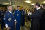 Soyuz TMA-15 crew. Roman Romanenko, Frank De Winne and Robert Thirsk receive a blessing before the launch